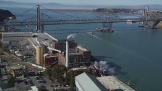 DFKSF08_040 - 5K stock footage aerial video of flying by C&H Pure Can Sugar Factory to Carquinez Bridge, Crockett, California
