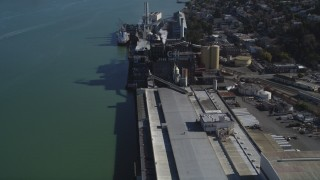 DFKSF08_041 - 5K stock footage aerial video of approaching the C&H Pure Cane Sugar Factory, Crockett, California