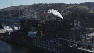 DFKSF08_042 - 5K stock footage aerial video of flying by the C&H Pure Cane Sugar Factory, Crockett, California