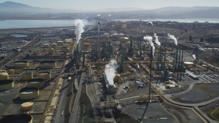 DFKSF08_047 - 5K stock footage aerial video of flying by the Valero Oil Refinery, Benicia, California