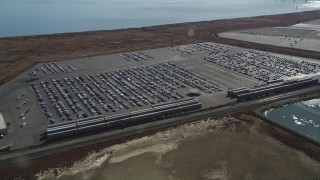 DFKSF08_049 - 5K stock footage aerial video of cars at the Valero Oil Refinery parking lot, Benicia, California