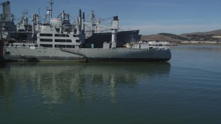 DFKSF08_054 - 5K stock footage aerial video of flying by warships from the National Defense Reserve Fleet, Suisun Bay, California