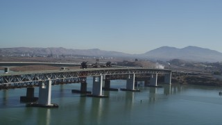 DFKSF08_057 - 5K stock footage aerial video of a reverse view of the Benicia-Martinez Bridge, California