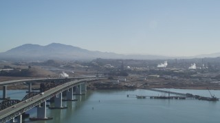 DFKSF08_058 - 5K stock footage aerial video pan from the Benicia-Martinez Bridge to the Shell Oil Refinery, California