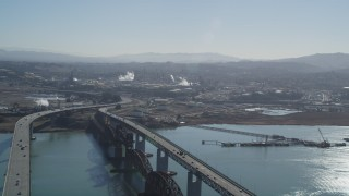DFKSF08_059 - 5K stock footage aerial video of flying by Benicia-Martinez Bridge near Shell Oil Refinery, Martinez, California