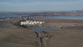 DFKSF08_065 - 5K stock footage aerial video of flying by oil refinery, Benicia-Martinez Bridge, Copart Auction, Martinez, California