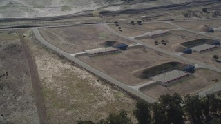 DFKSF08_069 - 5K stock footage aerial video of flying away from the Port Chicago weapons depot, Bay Point, California