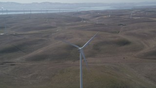 DFKSF08_076 - 5K stock footage aerial video of fly away from windmill at Shiloh Wind Power Plant, Montezuma Hills, California