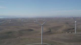 DFKSF08_077 - 5K stock footage aerial video flyby a row of windmills, Shiloh Wind Power Plant, Montezuma Hills, California