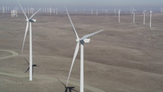 DFKSF08_079 - 5K stock footage aerial video of flying by windmills at Shiloh Wind Power Plant, Montezuma Hills, California