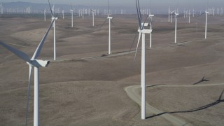 DFKSF08_081 - 5K stock footage aerial video of flying by windmills at Shiloh Wind Power Plant, Montezuma Hills, California