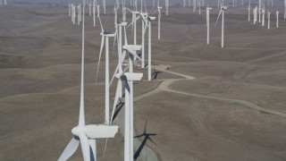DFKSF08_084 - 5K stock footage aerial video of passing a field of windmills, Shiloh Wind Power Plant, Montezuma Hills, California