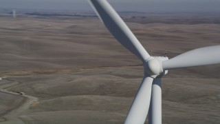 DFKSF08_085 - 5K stock footage aerial video fly near top of windmill, Shiloh Wind Power Plant, Montezuma Hills, California