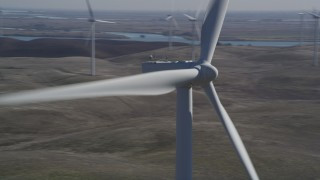 DFKSF08_086 - 5K stock footage aerial video orbit top of windmill, reveal more windmills, Shiloh Wind Power Plant, California