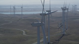 DFKSF08_087 - 5K stock footage aerial video of flying by row of windmills, Shiloh Wind Power Plant, Montezuma Hills, California