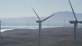 DFKSF08_089 - 5K stock footage aerial video of flying by tops of windmills at Shiloh Wind Power Plant, Montezuma Hills, California