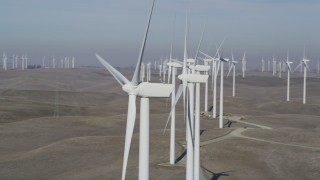 DFKSF08_092 - 5K stock footage aerial video of flying by windmills at the Shiloh Wind Power Plant, Montezuma Hills, California