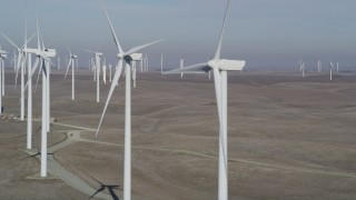 DFKSF08_093 - 5K stock footage aerial video of flying by windmills at Shiloh Wind Power Plant, Montezuma Hills, California