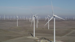 DFKSF08_094 - 5K stock footage aerial video flyby windmills while zooming out at Shiloh Wind Power Plant, Montezuma Hills, California