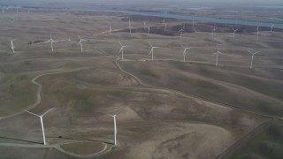 DFKSF08_096 - 5K stock footage aerial video of flying by field of windmills, Shiloh Wind Power Plant, Montezuma Hills, California