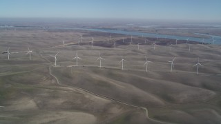 DFKSF08_097 - 5K stock footage aerial video of flying by a field of windmills, Shiloh Wind Power Plant, Montezuma Hills, California