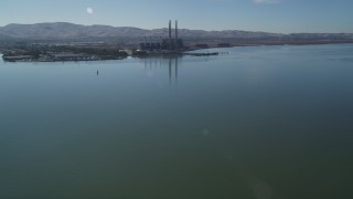 DFKSF08_098 - 5K stock footage aerial video of approaching a waterfront power plant, Pittsburg, California