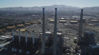 DFKSF08_100 - 5K stock footage aerial video of orbiting a power plant's smoke stacks, Pittsburg, California