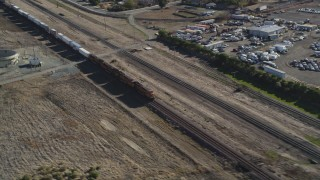 DFKSF08_104 - 5K stock footage aerial video of passing in front of a moving train, Pittsburg, California