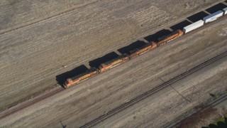 DFKSF08_105 - 5K stock footage aerial video of tracking a train passing through Pittsburg, California