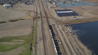 DFKSF08_106 - 5K stock footage aerial video of tracking a train traveling through Pittsburg, California
