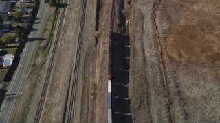 DFKSF08_107 - 5K stock footage aerial video of tracking a train traveling through Pittsburg, California