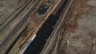 DFKSF08_108 - 5K stock footage aerial video of a train traveling through Bay Point, California