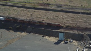 DFKSF08_109 - 5K stock footage aerial video of a train traveling through Bay Point, California