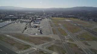 DFKSF08_113 - 5K aerial stock footage video approach parked airplanes at Buchanan Field Airport, Concord, California