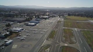 DFKSF08_114 - 5K stock footage aerial video of passing parked airplanes and hangars at Buchanan Field Airport, Concord, California