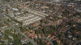 DFKSF09_001 - 5K stock footage aerial video of a reverse view of tract homes in a suburban neighborhoods, Pleasant Hill, California
