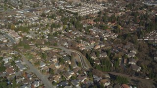 DFKSF09_002 - 5K stock footage aerial video of flying away from tract homes in a suburban neighborhoods, Pleasant Hill, California