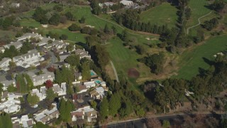 DFKSF09_003 - 5K stock footage aerial video of a reverse view of Contra Costa Golf Club, reveal apartment buildings Pleasant Hill, California