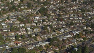 DFKSF09_004 - 5K stock footage aerial video of a reverse view of tract homes in residential neighborhoods, Martinez, California