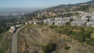 DFKSF09_011 - 5K stock footage aerial video of flying by hilltop apartment buildings, Oakland Hills, California