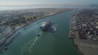 DFKSF09_018 - 5K stock footage aerial video of tracking a cargo ship by the Port of Oakland, California