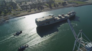 DFKSF09_019 - 5K stock footage aerial video of tracking a cargo ship in the Port of Oakland, California