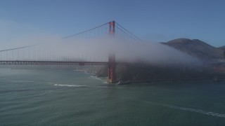 DFKSF09_023 - 5K stock footage aerial video of approaching the Golden Gate Bridge wrapped in fog, San Francisco, California