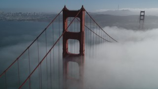 DFKSF09_026 - 5K stock footage aerial video of flying above fog over Golden Gate Bridge, and reveal Downtown San Francisco, California