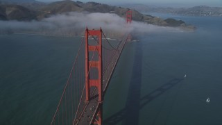 DFKSF09_030 - 5K stock footage aerial video of the Golden Gate Bridge with light fog, San Francisco, California