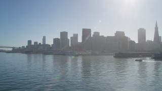 DFKSF09_044 - 5K stock footage aerial video flyby piers, with a view of the skyline in Downtown San Francisco, California