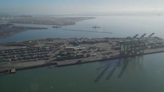 DFKSF09_055 - 5K stock footage aerial video flyby the Port of Oakland, California
