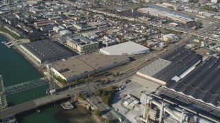 DFKSF09_060 - 5K stock footage aerial video of flying away from factories and warehouses in Oakland, Alameda, California