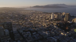 DFKSF10_002 - 5K stock footage aerial video pan across Marina District to Russian Hill, San Francisco, California, sunset