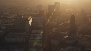 DFKSF10_011 - 5K stock footage aerial video of flying over Market Street through Civic Center, Downtown San Francisco, California at sunset